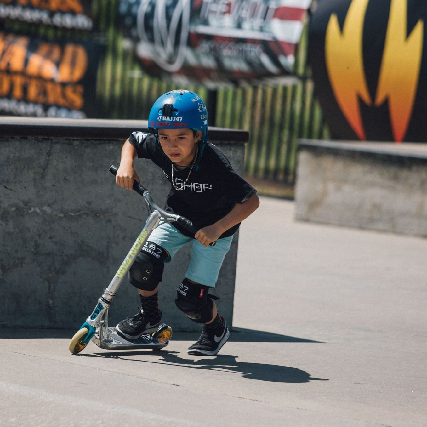 Child on scooter at skate park